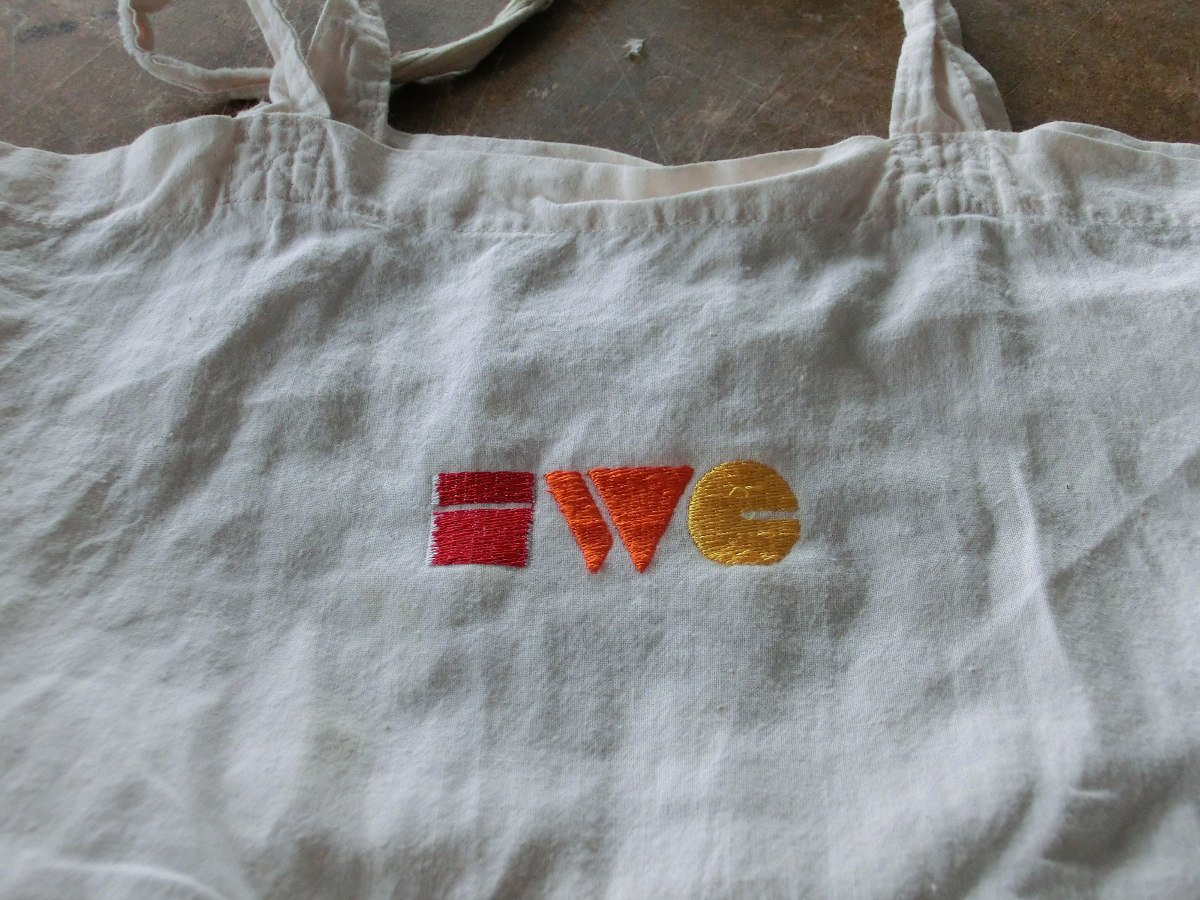 Photo of a linen handbag with the IndieWebCamp logo sewn into it