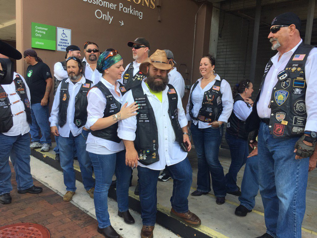 bikers stand guard against westboro baptist protesters
