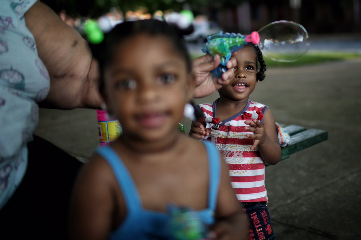 Zerenity and Zaniyah play in an apartment complex courtyard while @fomhbg goes on there weekly patrol. @PennLive https://t.co/lcUxV6ccOt