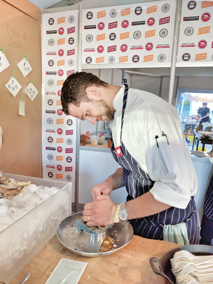 Chef Carl Heinrich shucking oysters at Taste of Toronto for Richmond Station