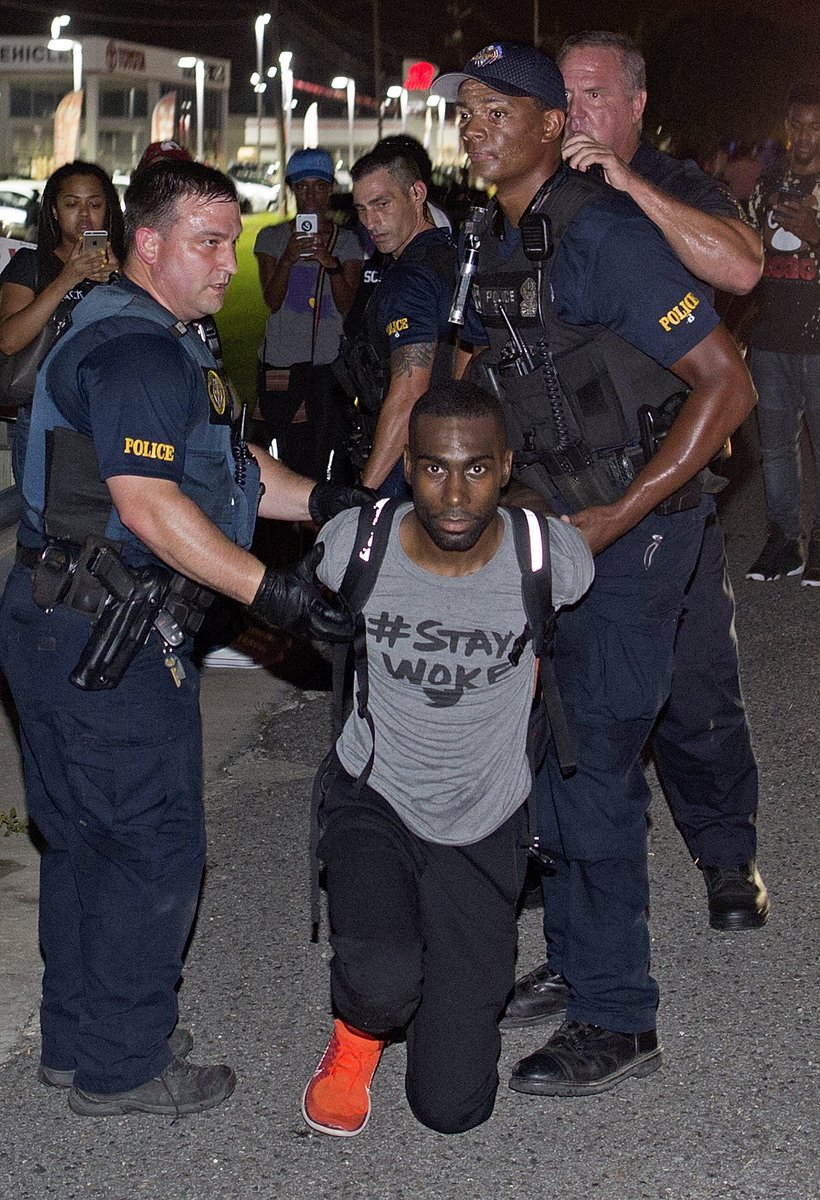 Activist @deray arrested in Baton Rouge; police use smoke bombs to clear protesters in Minn. https://t.co/9s4RDwzRgE https://t.co/fEmaYLaKvV