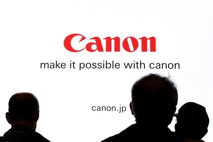 Japan regulator approves Canon deal to buy Toshiba unit, warns on method