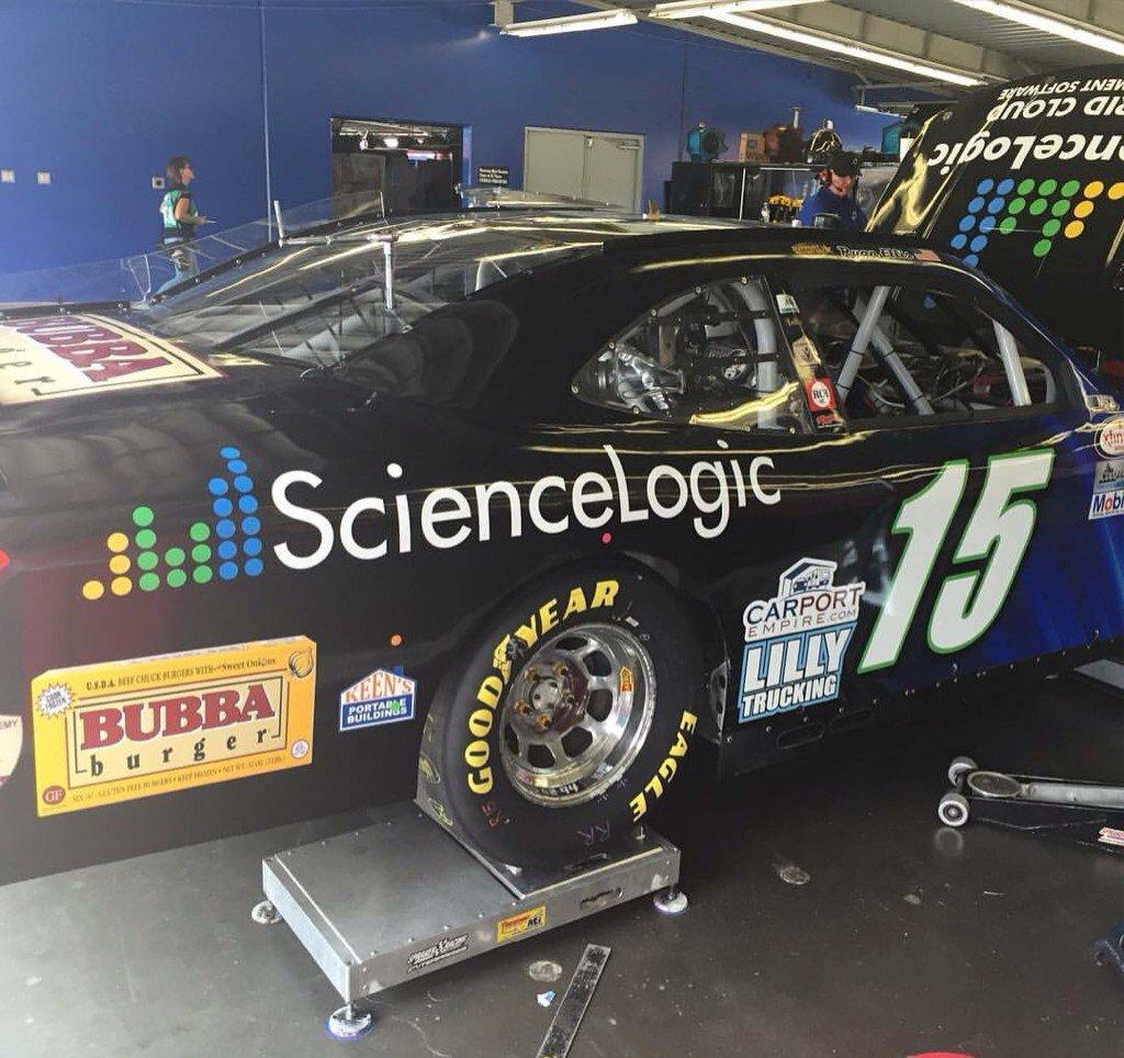 The #15 @ScienceLogic car of @ryanellisracing car rolling through tech! #BubbaBurger @LillyTrucking, @carportempire https://t.co/XizLK7MFkm