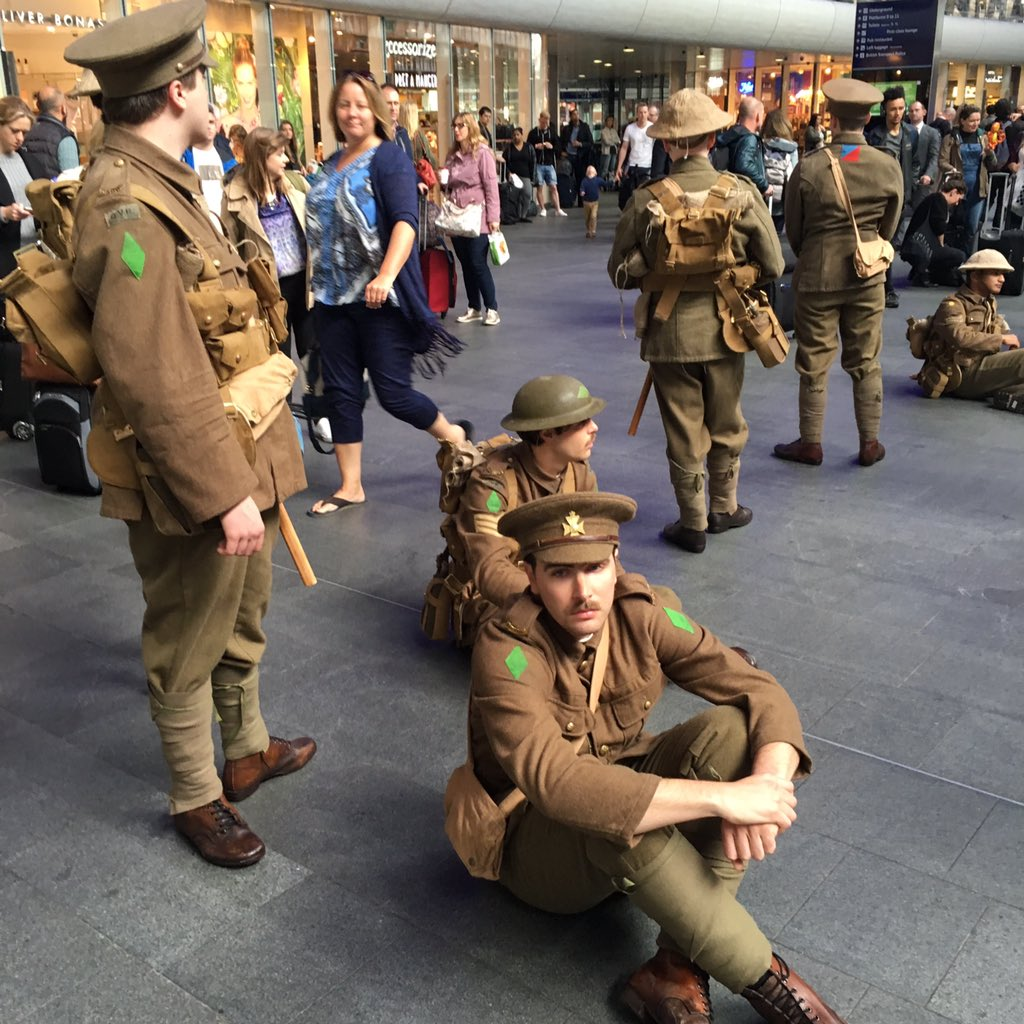 KingsX: WW1 soldiers silently mingle w/ commuters handing out cards bearing names of #Somme100 dead + #wearehere https://t.co/jTXjNPLLGu