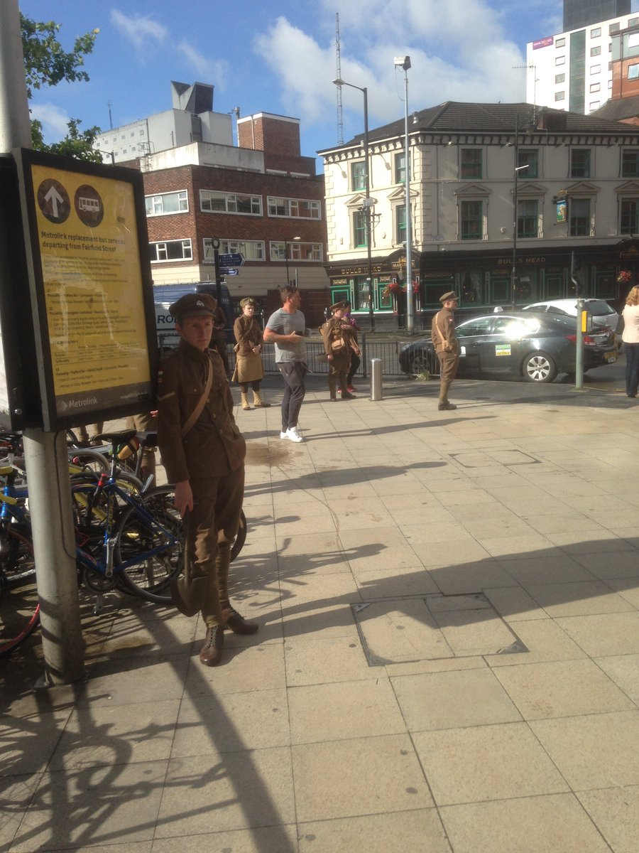 WW1 soldiers at Manchester Piccadilly. They say nothing, give you a card. Walking ghosts. In tears. #wearehere https://t.co/r1nKVSv7DV
