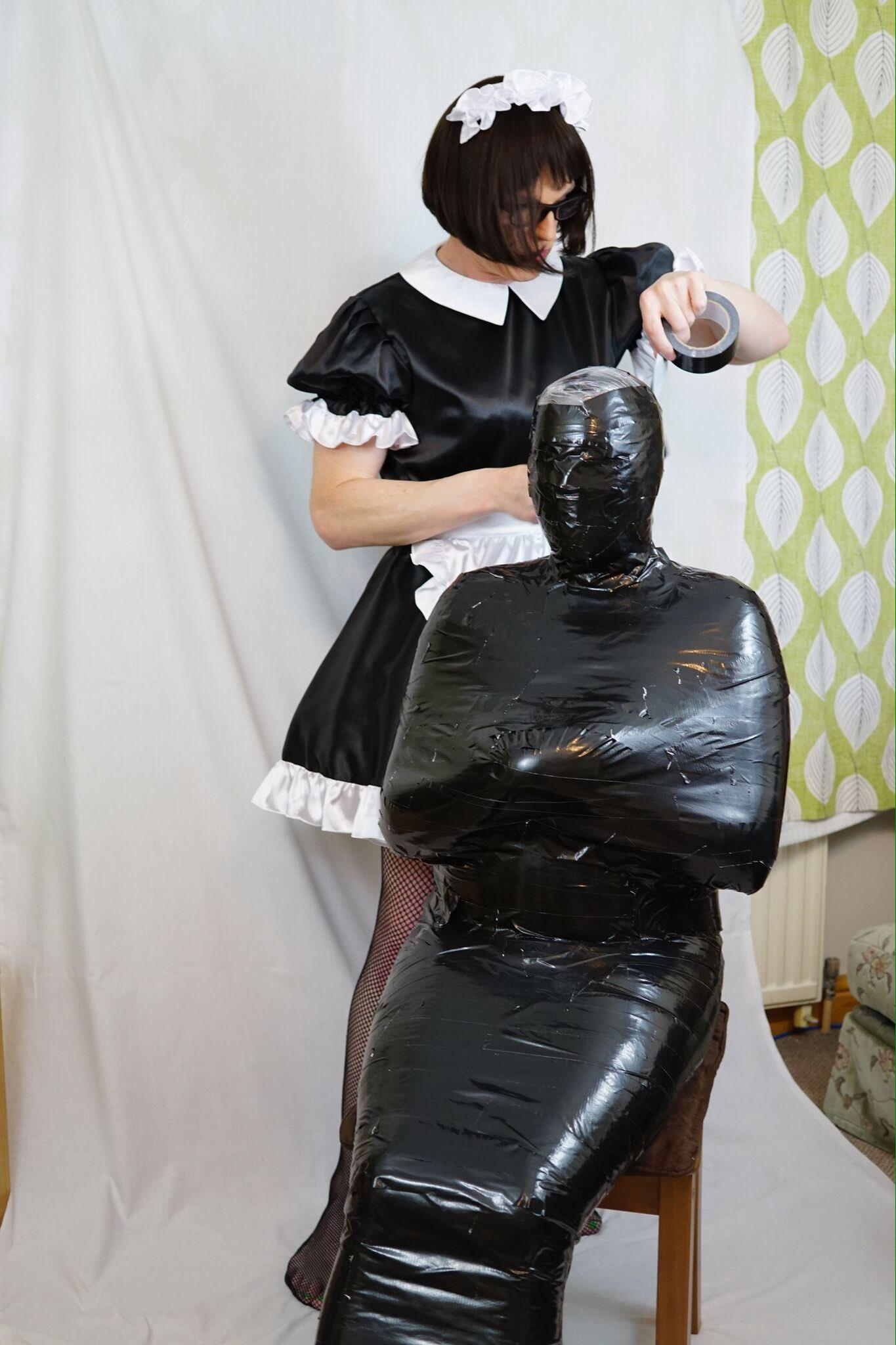 Bondage latex mummy