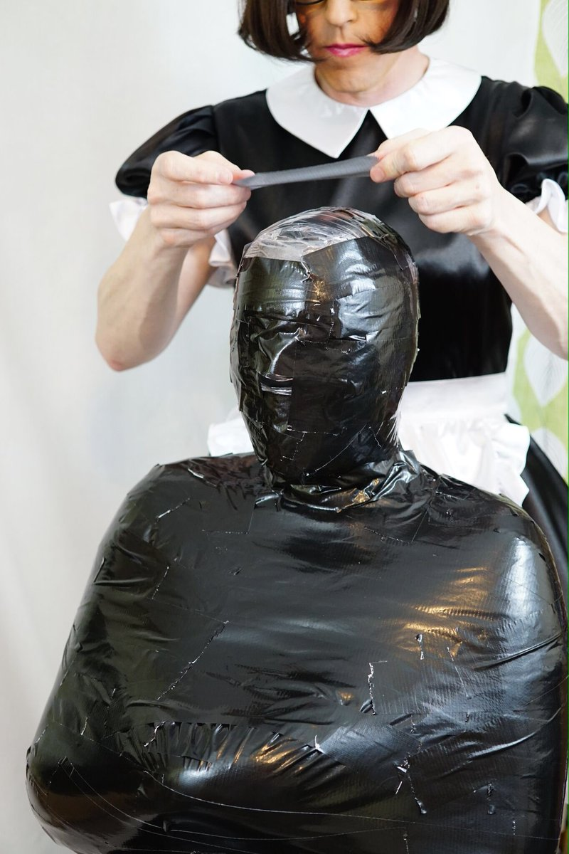 Duct tape mummified girl stands hops - 1 10