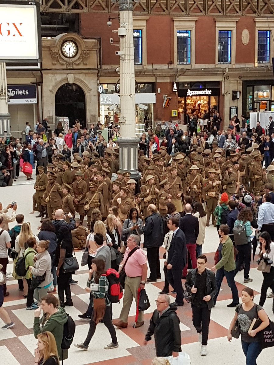 This lot just belted out #WeAreHere in the middle of rush hour at Victoria. Incredibly moving. https://t.co/ziIA2tNav0