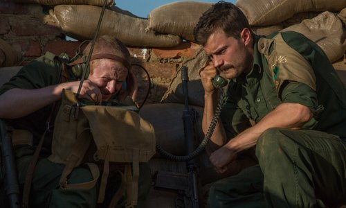 Latest images from #TheSiegeOfJadotville starring #JamieDornan released https://t.co/TqQWTJs86t https://t.co/r9rOI19b46
