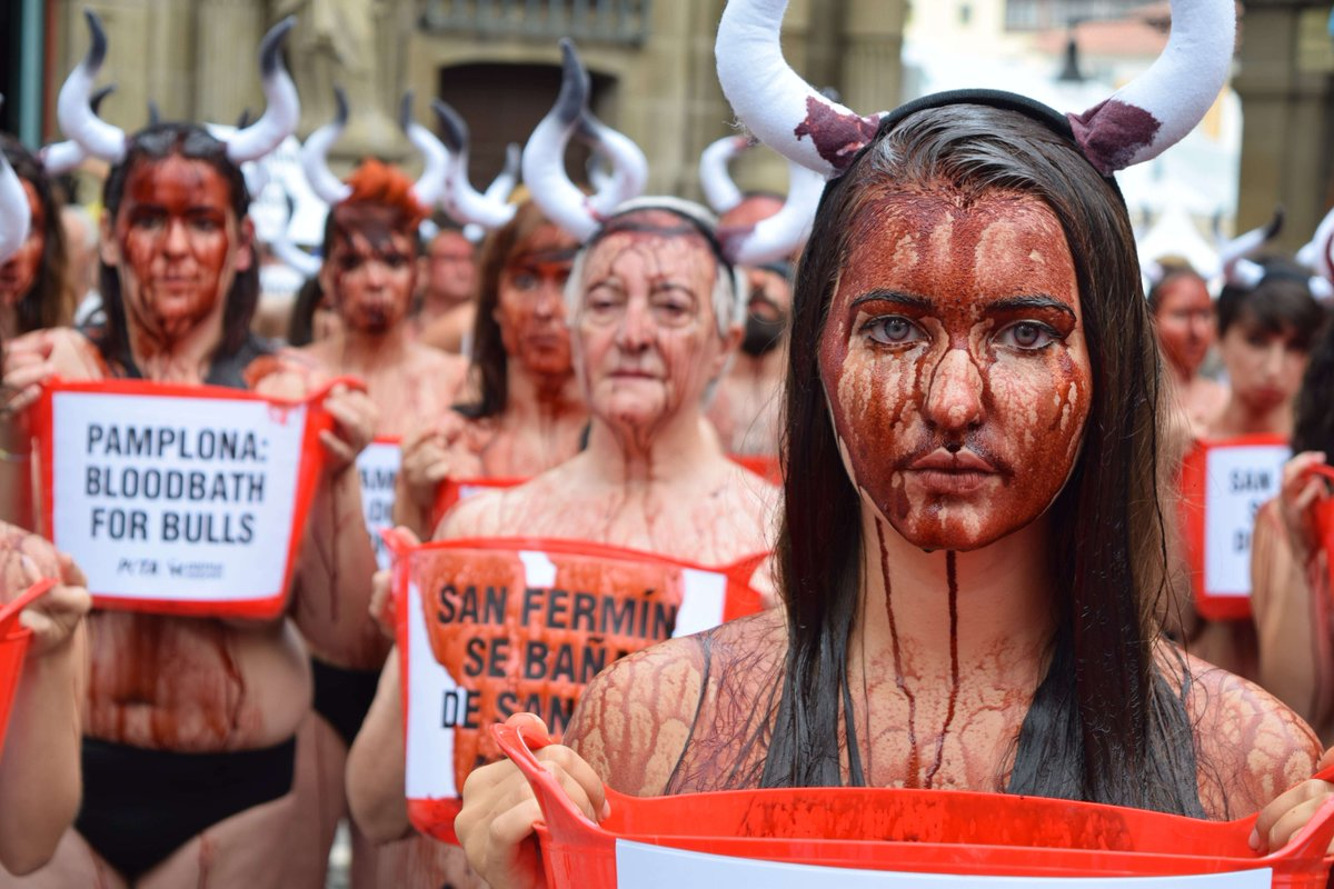 Peta protesters lie naked in pamplona to protest bullfights