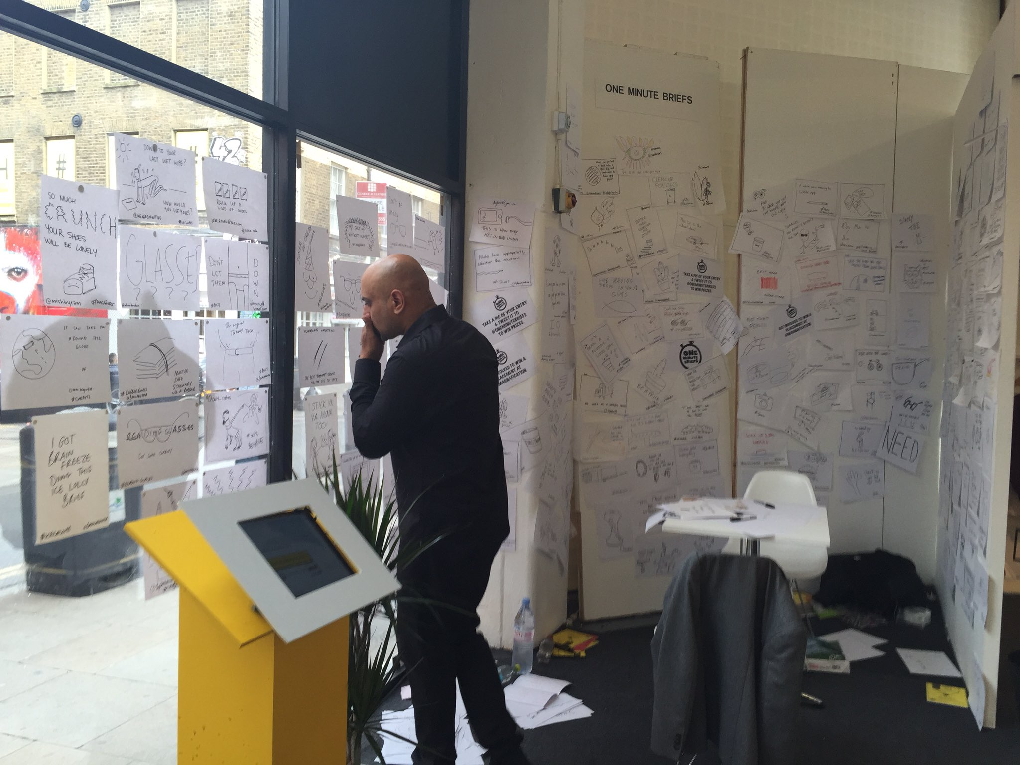 The @OneMinuteBriefs wall at #NewBlood16 is now the 'wall and windows'. About 30 briefs in today https://t.co/PYXPQGLz95