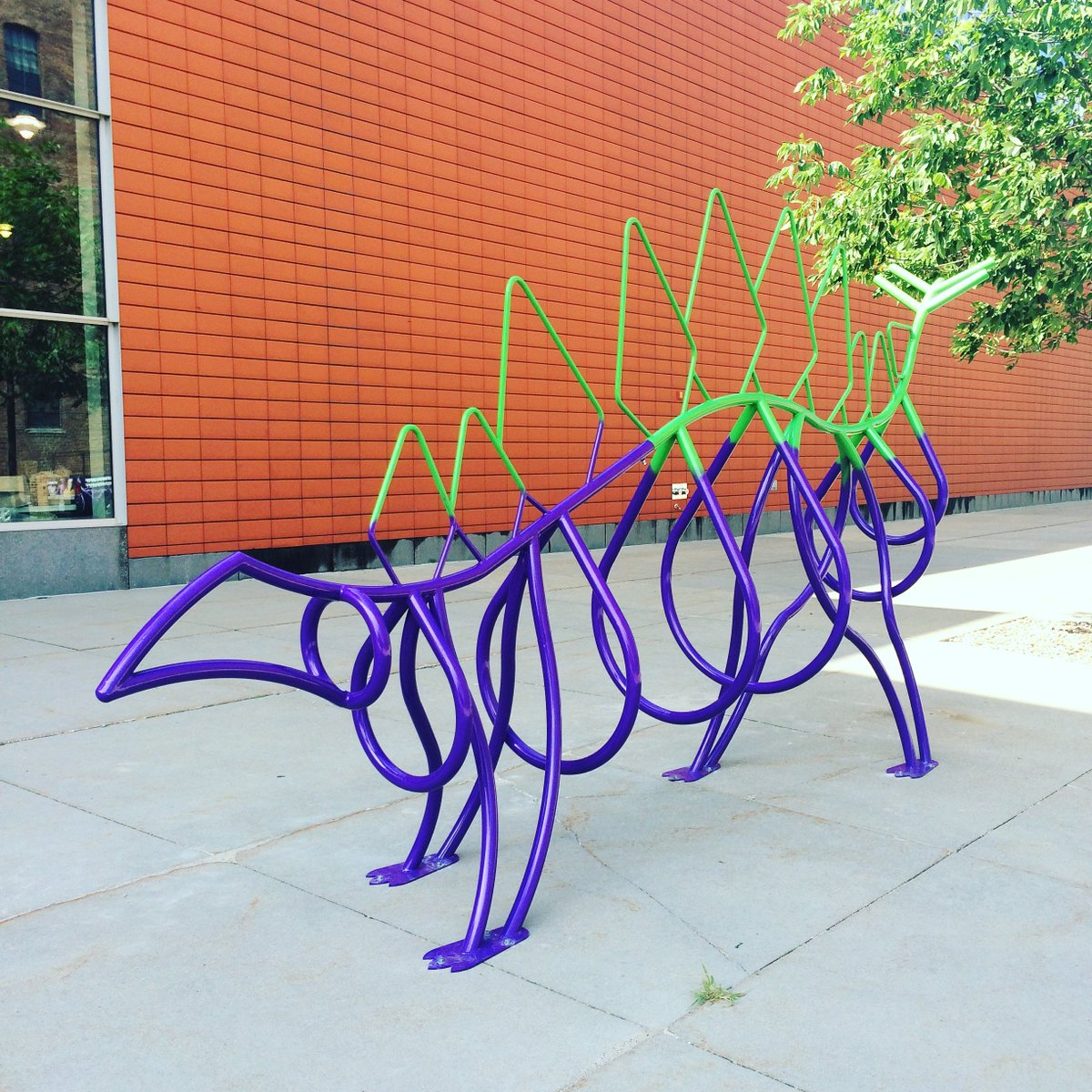 Our dinosaur bike rack is officially INSTALLED! Ride your bike to SCI! https://t.co/wawHm8pjEc