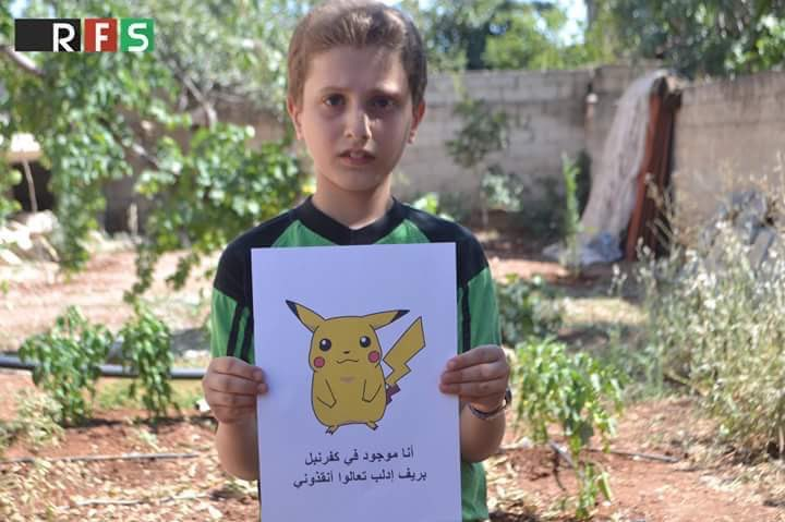 Syrian children holding Pokemon photos in hopes the world will find them and save them