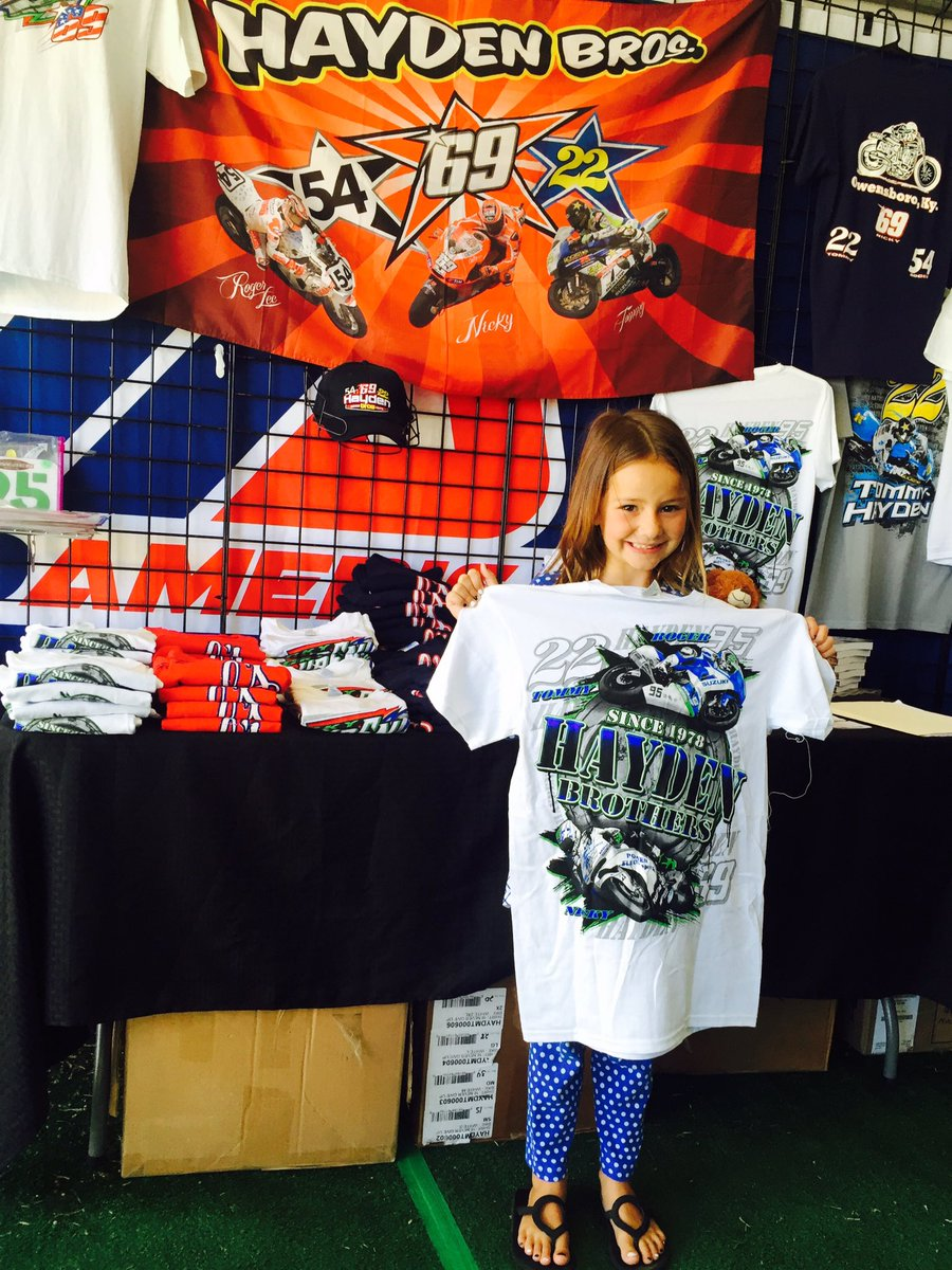 Klaudia with all the cool Hayden Bros gear in the MotoAmerica booth! It's going to be a great day of racing!