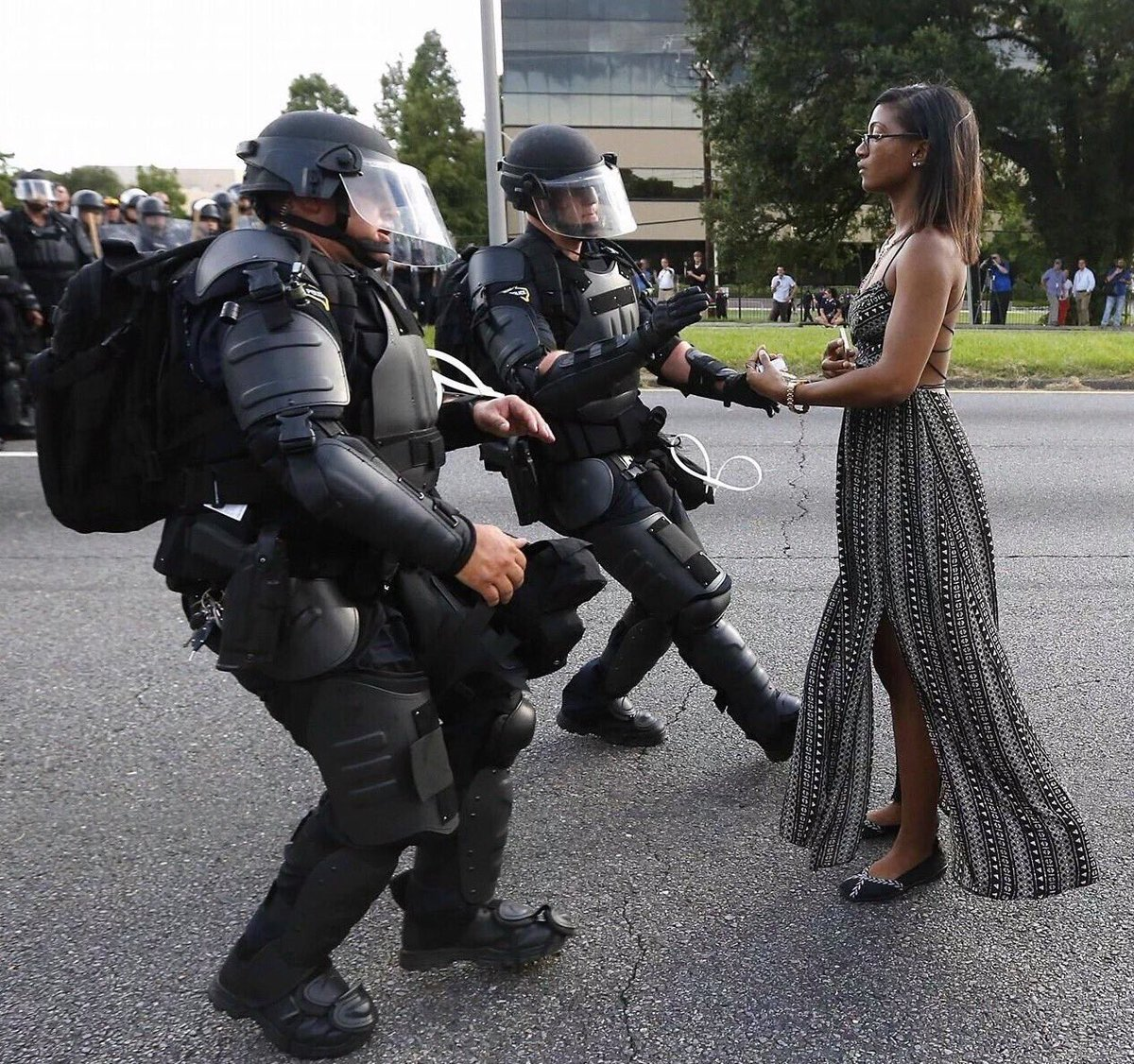 Photo of police in riot gear arresting protester in a dress strikes chord on social media