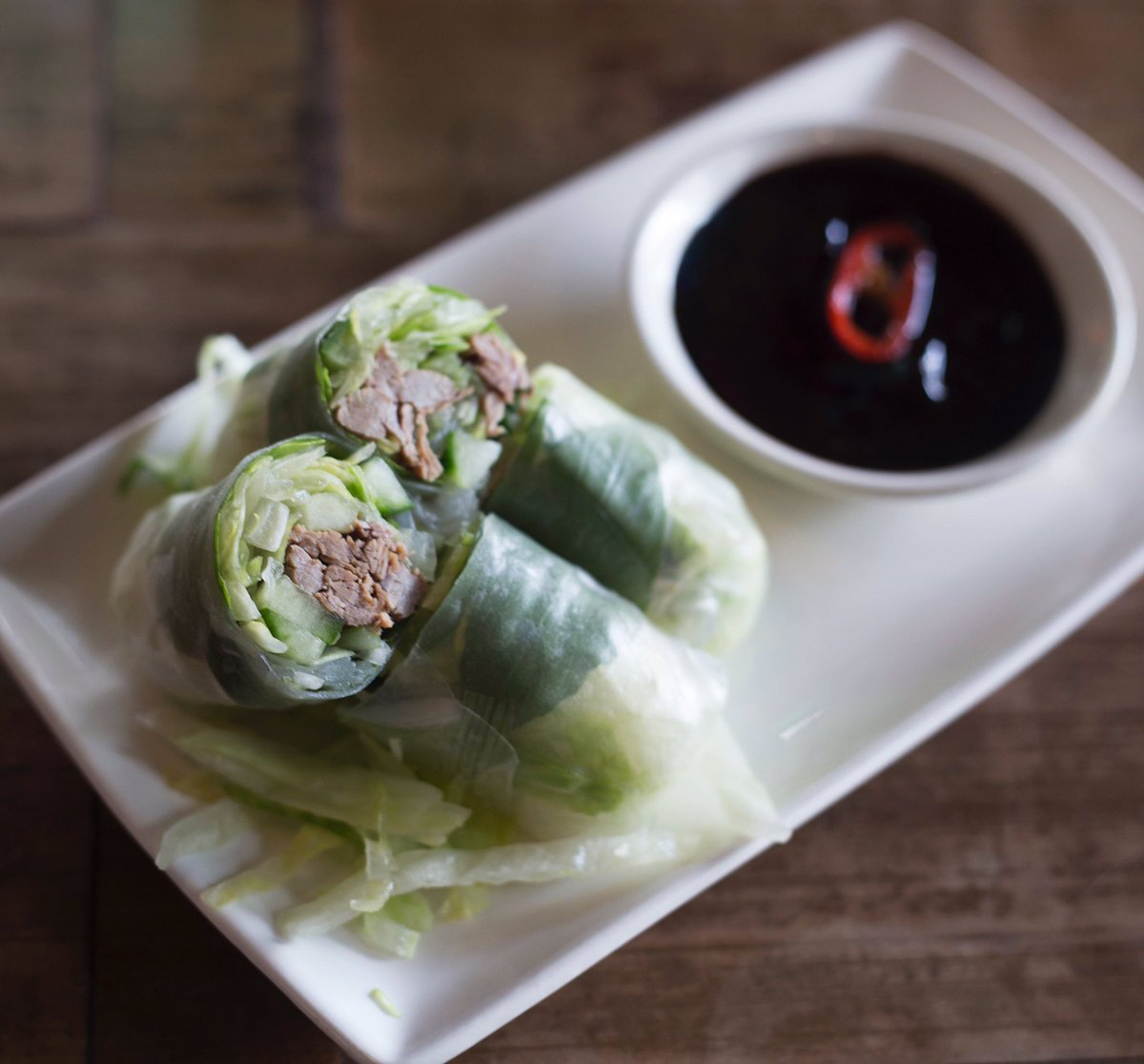 Try our new beef brisket summer rolls w/ Thai basil & cucumber, served w/ #glutenfree hoisin #delicious #summerofPho https://t.co/RRXCj908gO