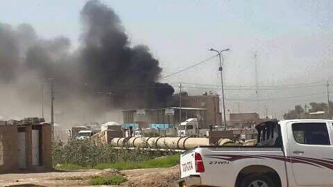 Car bomb targets checkpoint in al-Husseiniya suburb north of Baghdad Iraq