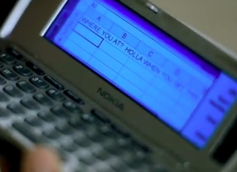 Old Nokia phone with a spreadsheet on the screen.