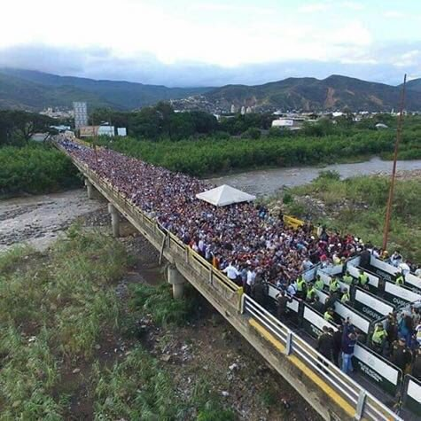 Today: Venezuelans crossing the border to buy food in Colombia.,