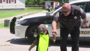 Young boy believes police officers are Batman