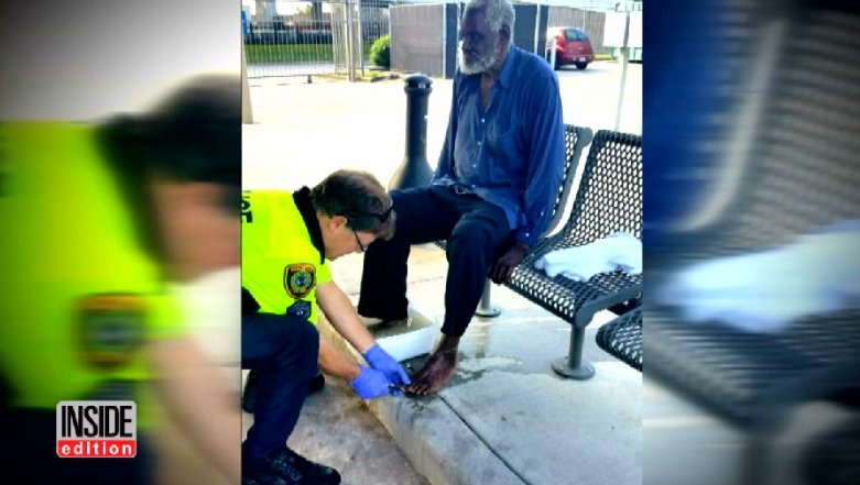 Police officer photographed kneeling to clean homeless man's feet: 'You just feel compassion'