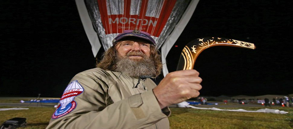 A russian balloonist claiming a new around-the-world balloon flight record lands safely.