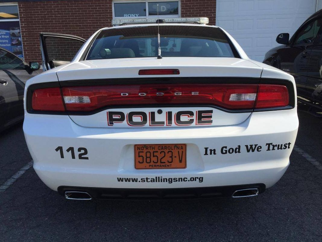 North Carolina police add 'In God We Trust' to cars in response to recent national violence.