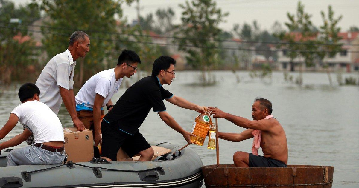 Massive floods in China kill at least 154 people; more than 120 others are missing