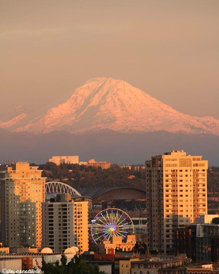 Mount Rainier lookin' out over her city! Thanks, Felotio B. Share your photos with us >>