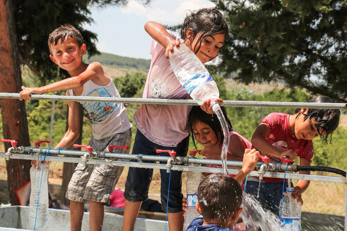 In #Greece we help refugees access water for drinking, washing--& playing! Learn more: https://t.co/WmFXU7gxKc https://t.co/m2bbcNQj3o