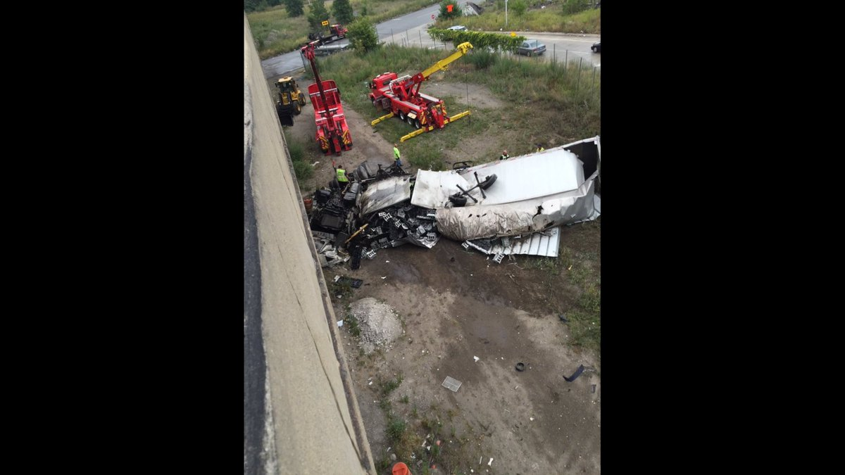 Semi crashes over barrier at I-75 and Dearborn St., MDOT details clean-up plan.