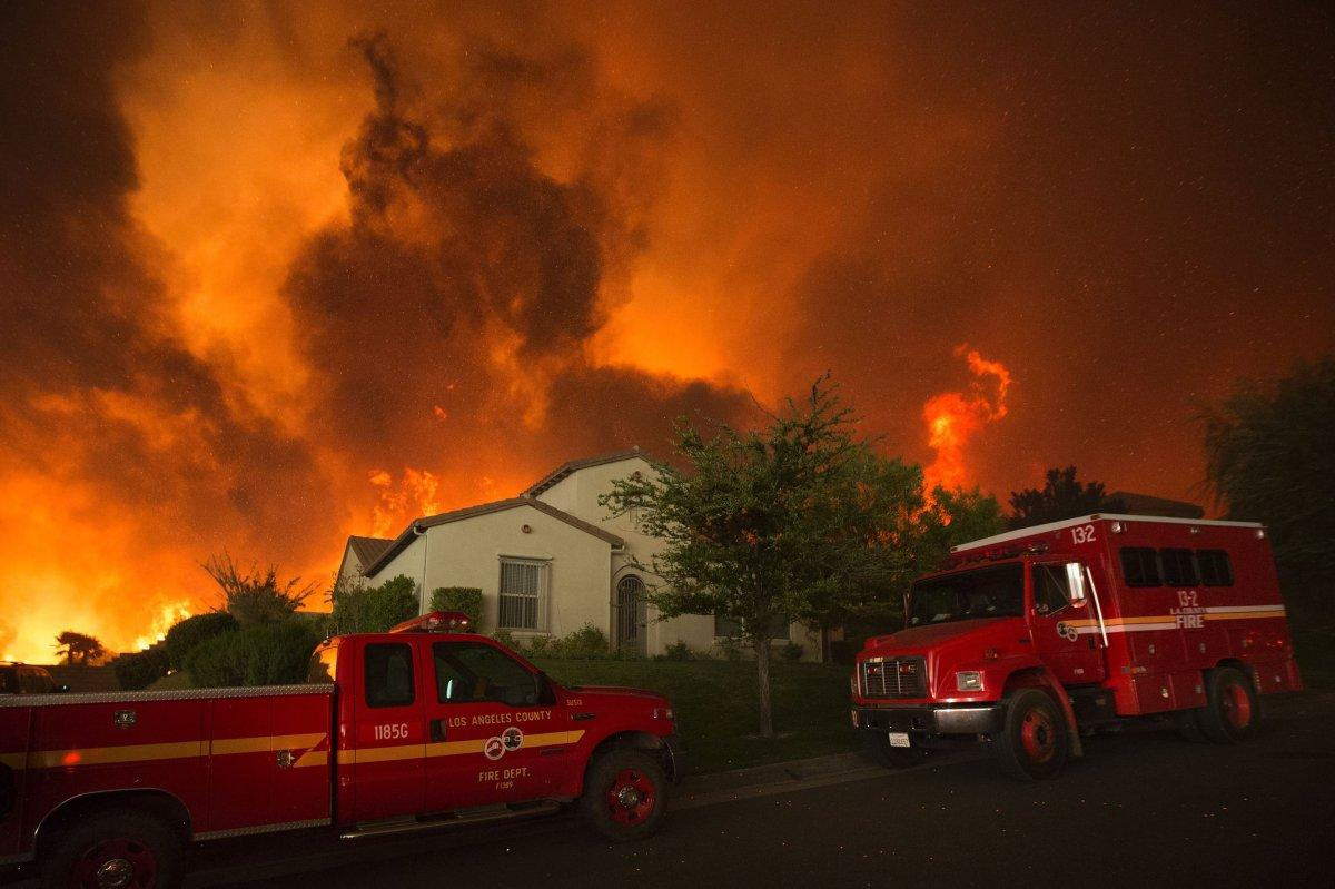 South California wildfire destroys at least 18 homes, officials find burned body