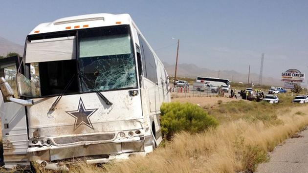 At least one person is dead after a Dallas Cowboys bus collided with another vehicle.
