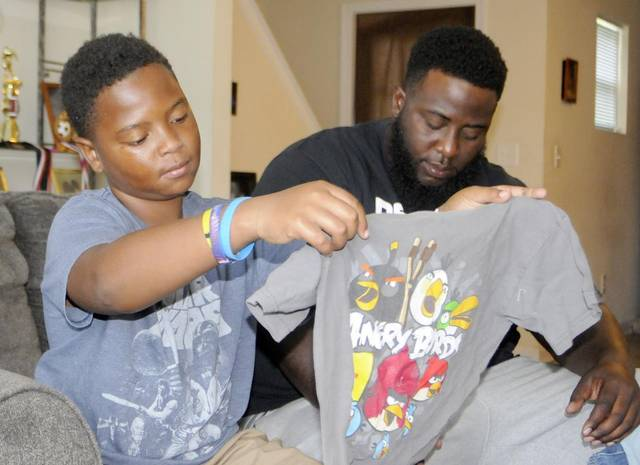 Classmate teased for worn clothes, so Charlotte area boy steps in to help