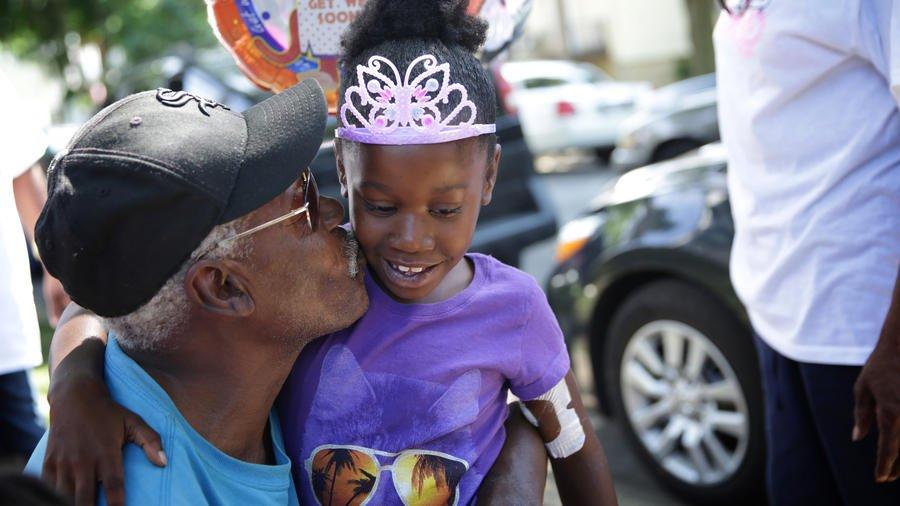 6-year-old girl shot last week returns home to neighborhood celebration
