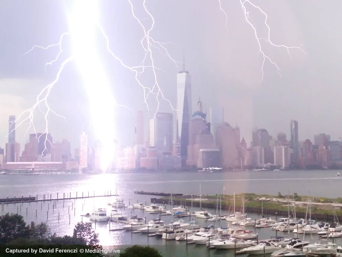 Lightning cascades down from clouds over NYC during Monday's storms (Credit: David Ferenczi)