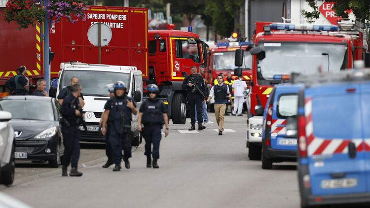 Priest, 2 assailants killed after attack on church in France.