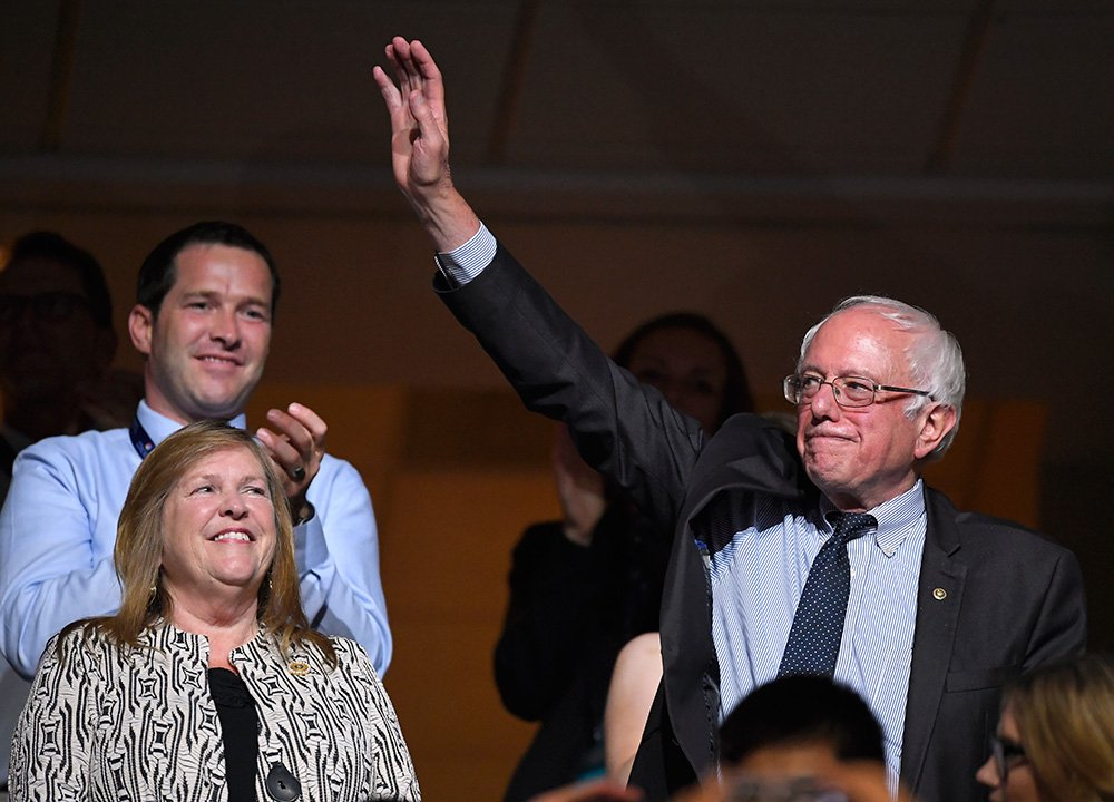 Democratic roll call nears climactic end, and Bernie Sanders joins the Vermont delegation