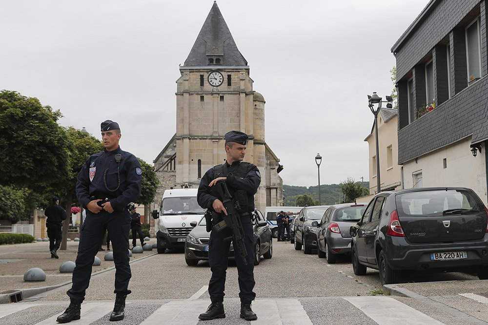 Hostage: Normandy church attackers forced husband to film slain priest.