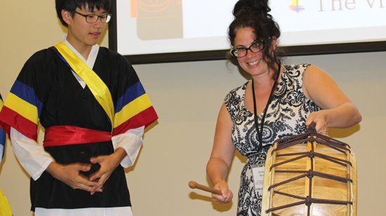 A student from Hana Academy Seoul shows a U.S. teacher how to play the 'buk' (drum) at the #HanaStanford conference https://t.co/zcfn76O5df