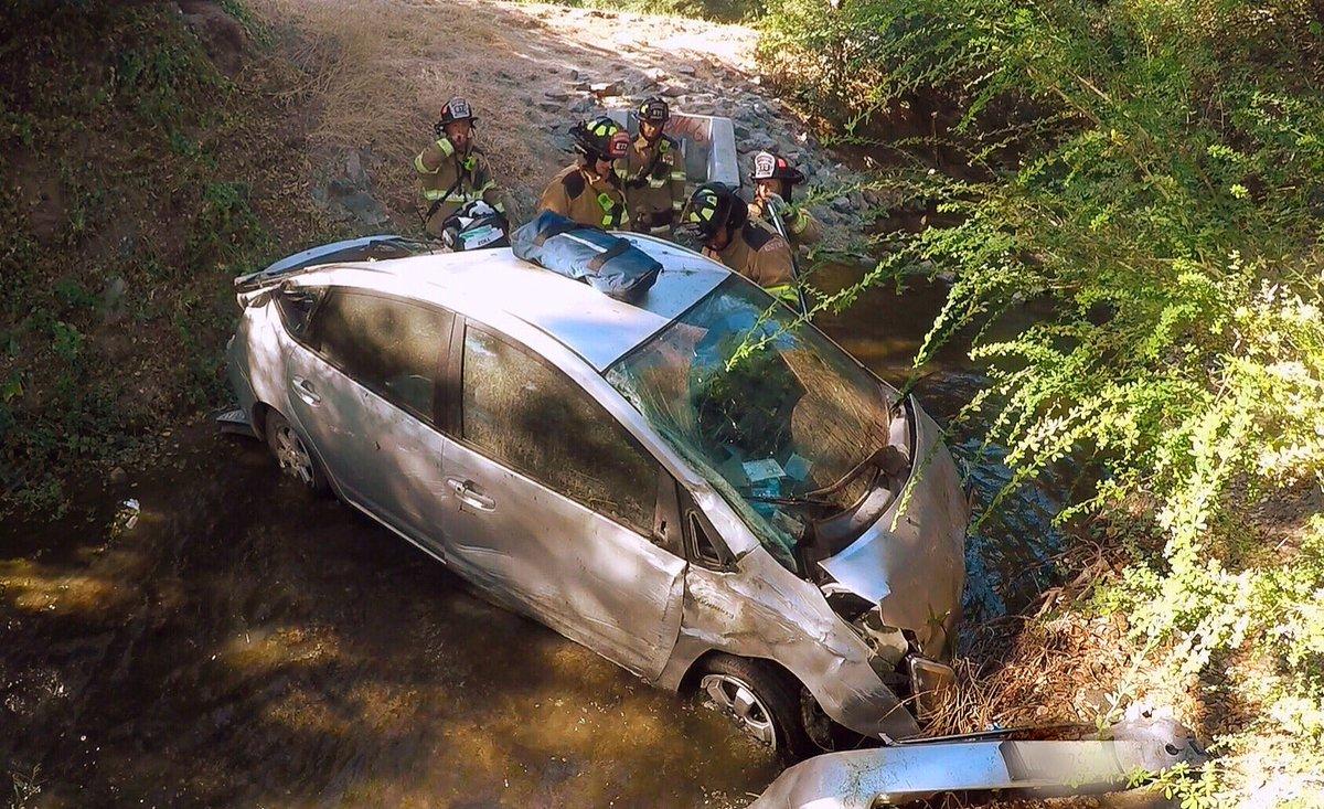 Car falls into creek bed in Saratoga.