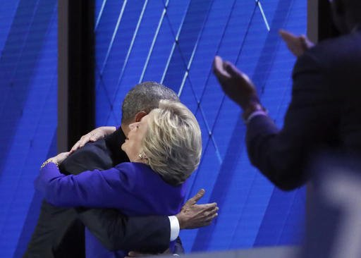 Signed, sealed, delivered: Clinton joins Obama onstage for passing of the baton