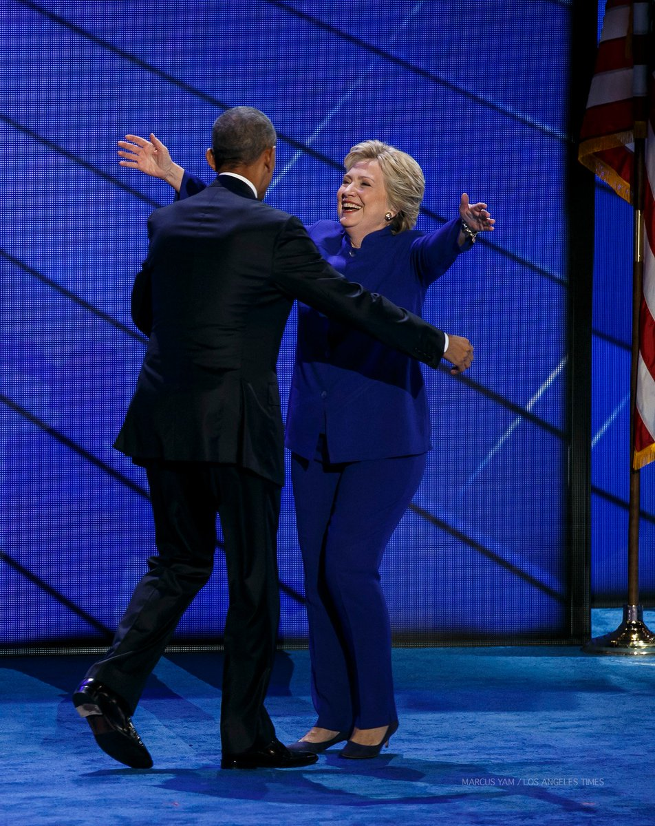 Hillary Clinton joins President Obama on stage after his speech at the DNC.
