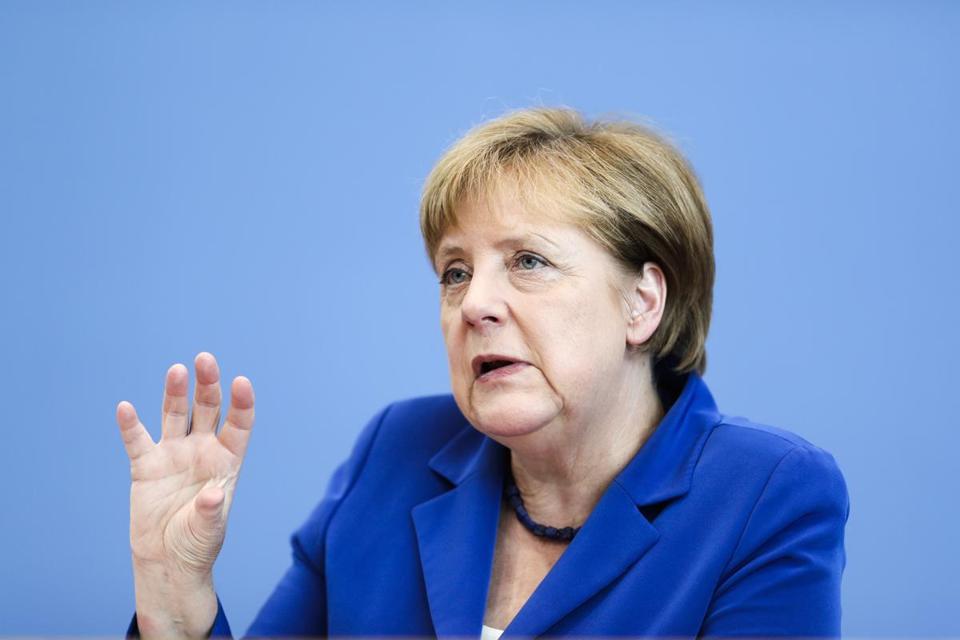 Angela Merkel says attacks by refugees mock Germany's hospitality