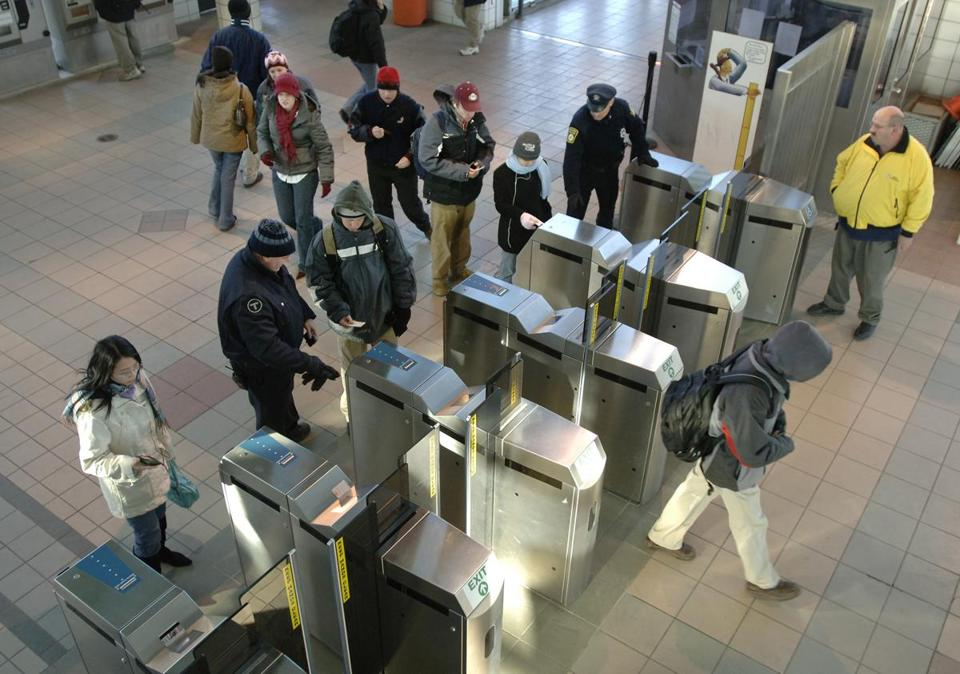 Baker signs law that lowers the cap on MBTA fare hikes