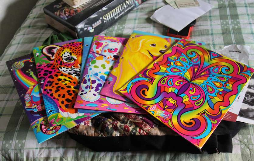 Remember Lisa Frank? Now she's making clothes, adult coloring books