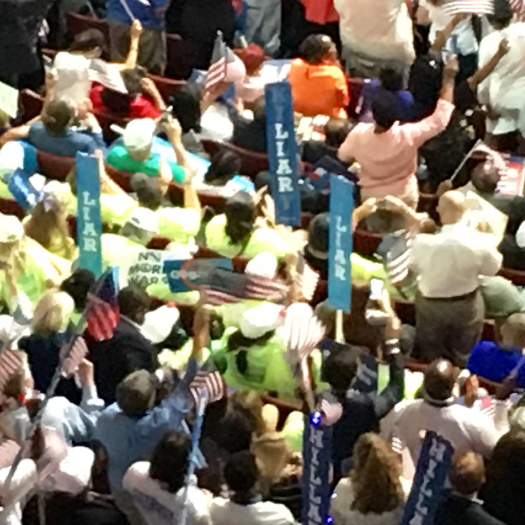 """Wow. Look closely. A few @SenSanders supporters have snuck in signs that read """"Liar."""" Ouch. #DemsInPhilly #DNCinPHL https://t.co/gJLvhAzMVS"""