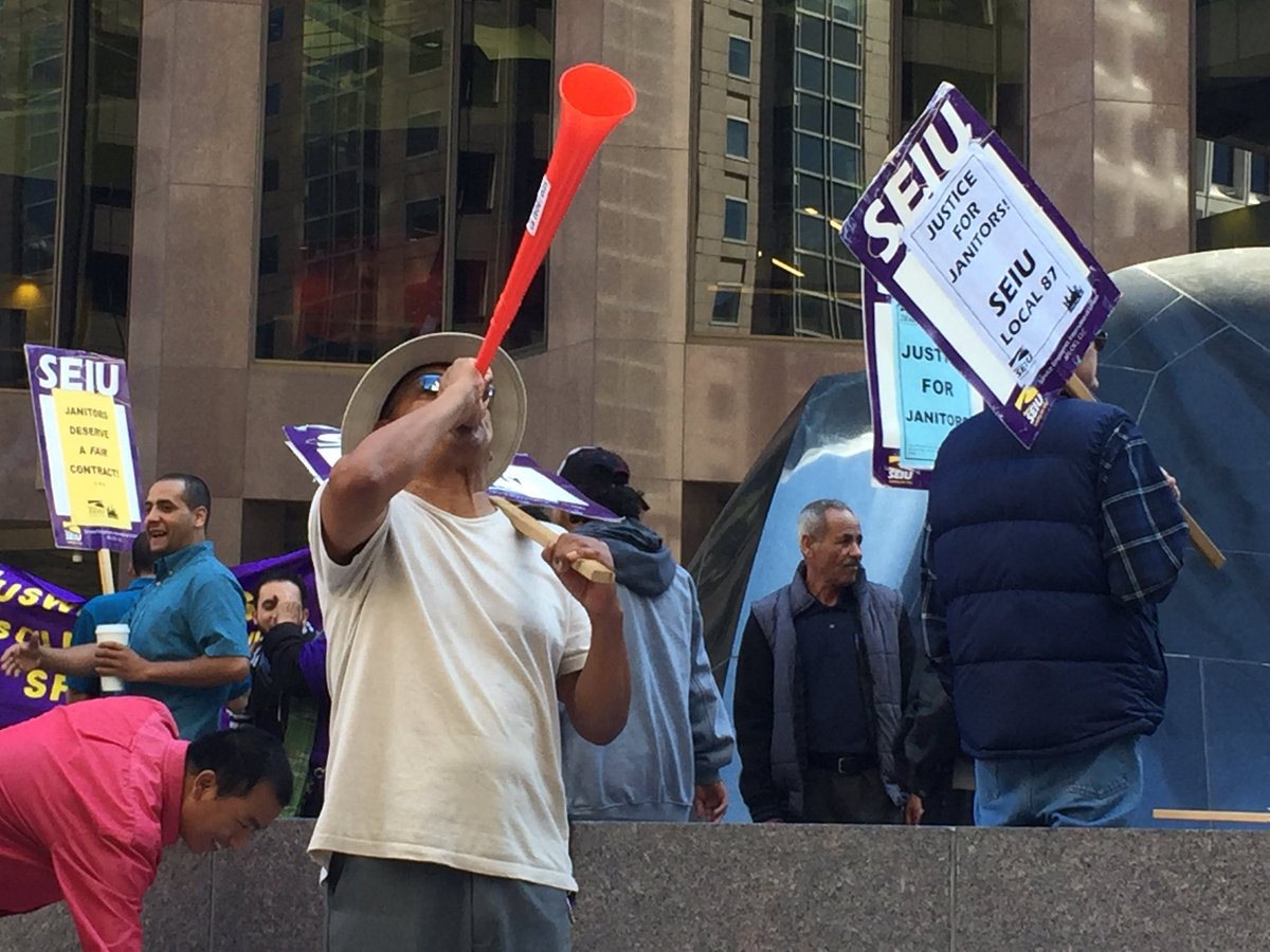 Janitors with SEIU 87 demonstrating at 555 California St. for better wages, health care