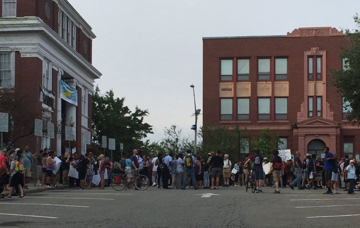 Police officers are rallying tonight in Somerville over BlackLivesMatter banner