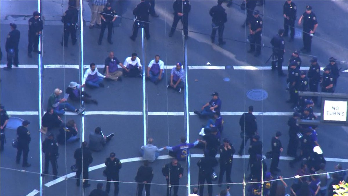 @SFPD arresting protesting janitors blocking traffic at Market & 1st St. SEIU present